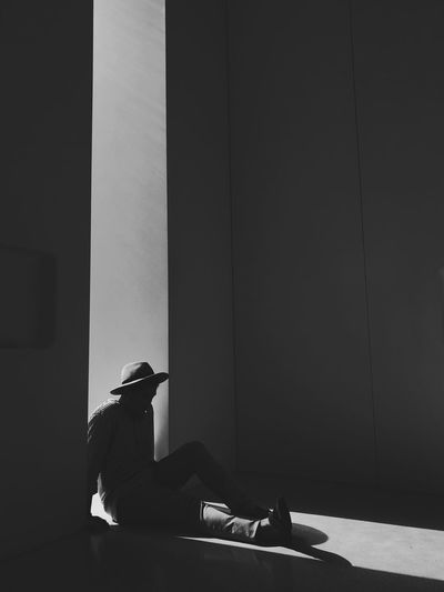 Alone EyeEm Best Shots EyeEmNewHere Monochrome One Person Real People Sitting Full Length Lifestyles Wall - Building Feature Men Shadow Sunlight