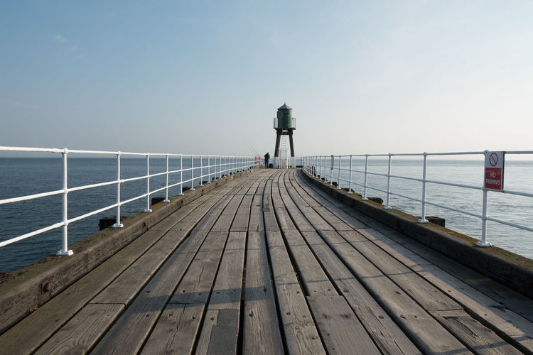 Whitby Whitby Harbour Whitby View Whitby North Yorkshire North Yorkshire North Yorkshire Coast Whitby Pier Seaside Seaside Town Sea Standing Outdoors Wood Paneling Scenics - Nature Horizon Horizon Over Water One Person Wood - Material Pier Sky Water Railing Direction The Way Forward Tranquility