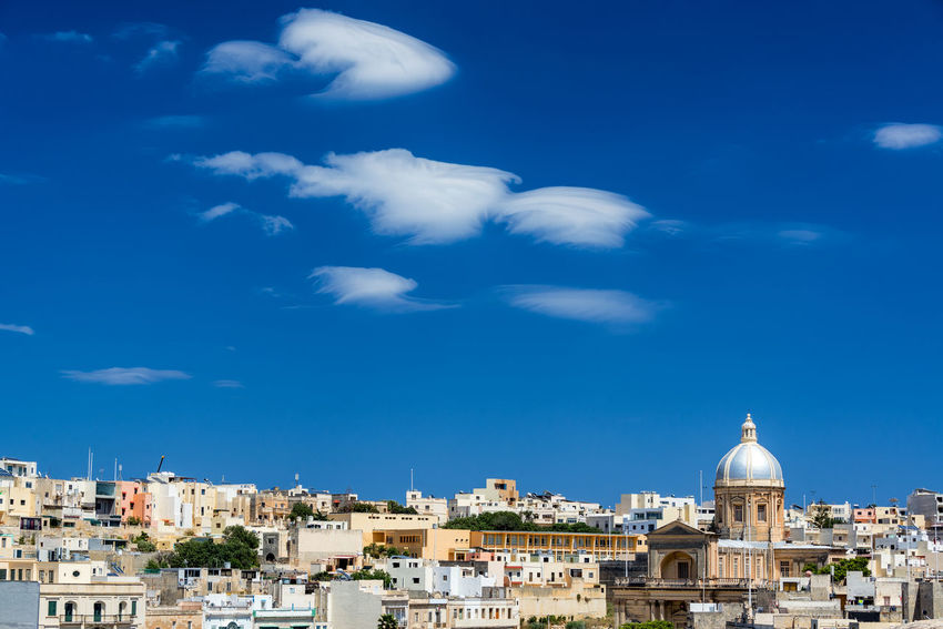 Cityscape view of Kalkara, Malta with blue sky and interesting clouds and St. Joseph Church Malta Architecture History Mediterranean  Island Travel Destinations Travel Tourism Historic Medieval Medieval Architecture No People Day Built Structure Kalkara St Joseph Church Religion Cityscape TOWNSCAPE Place Of Worship Dome Sky Cloud - Sky City