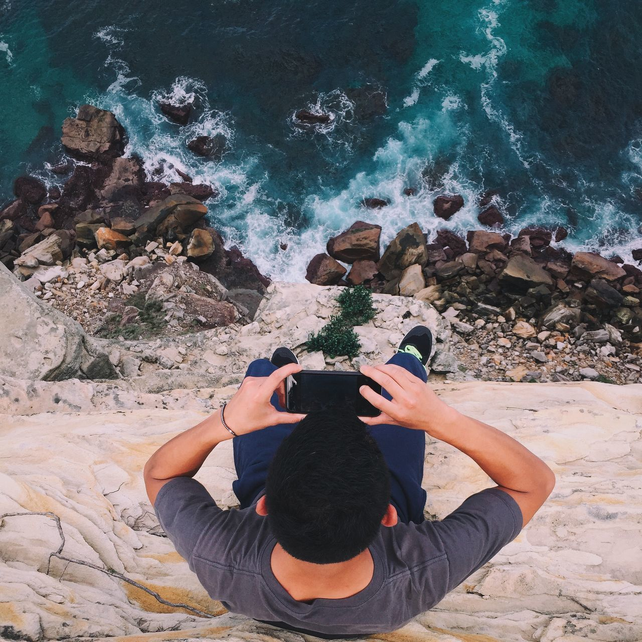 High angle view of man photographing sea