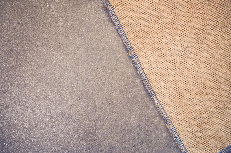 Close-up of burlap sack on floor