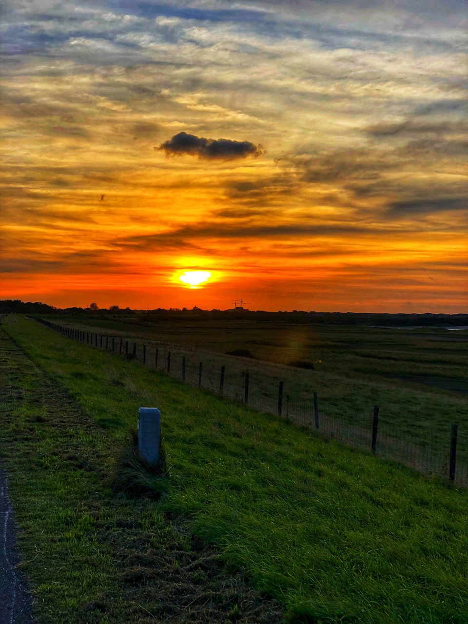 sky, sunset, landscape, environment, cloud - sky, tranquility, land, tranquil scene, field, scenics - nature, grass, nature, beauty in nature, no people, orange color, barrier, fence, boundary, rural scene, sun, outdoors