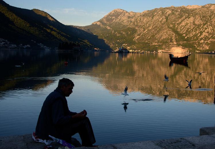 Man sitting by lake