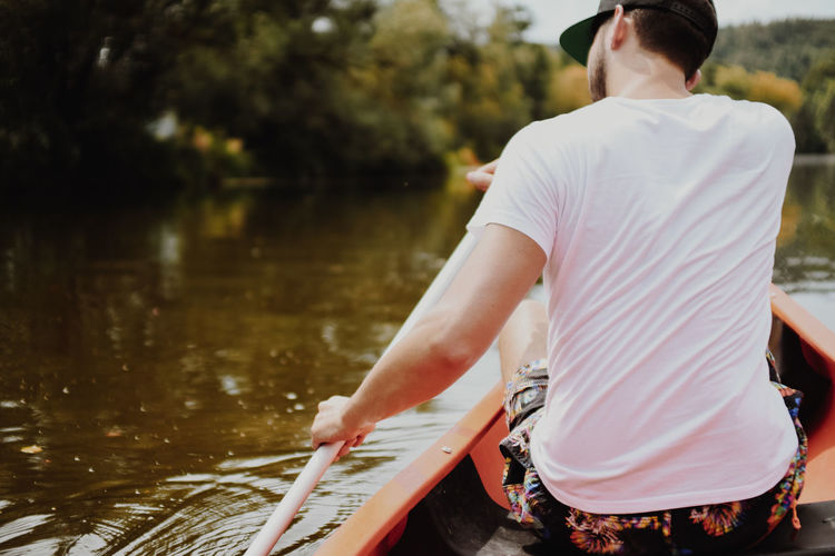 Canoeing on a river Canoe Canoeing Vacations Activity Boat Boat Trip Canoe Paddling Day Family Time Kanu Leisure Leisure Activity Lifestyles Men Nature Nautical Vessel Oar Outdoors Outside Paddling Real People Renting A Boat River Transportation Water