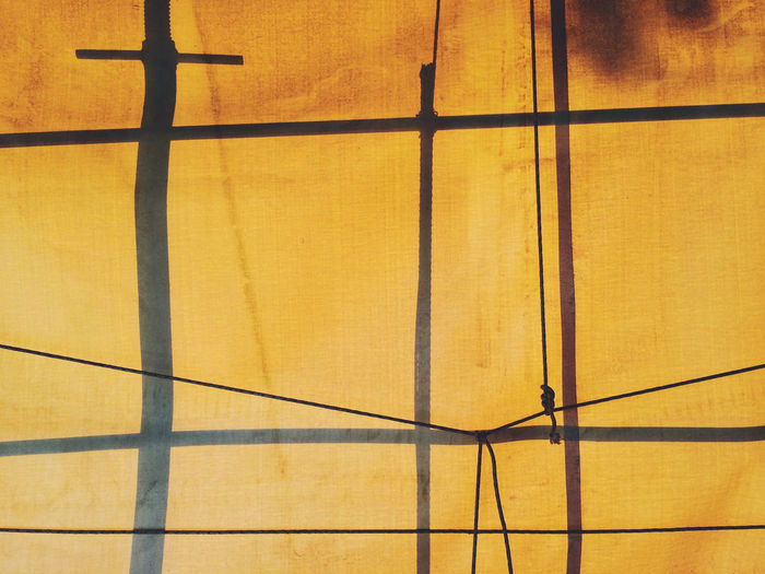 Yellow tarp with scaffolding shadows. Kefalonia, Greece. Photo by Tom Bland. Construction Construction Site Copy Space Geometric Shapes Graphic Lines Minimalist Paint The Town Yellow Scaffolding Shadowplay Shadows And Backlighting Abstract Background Backgrounds Geometric Minimal Minimalism Minimalobsession Shadows Texture Urban Yellow Fresh On Market 2017