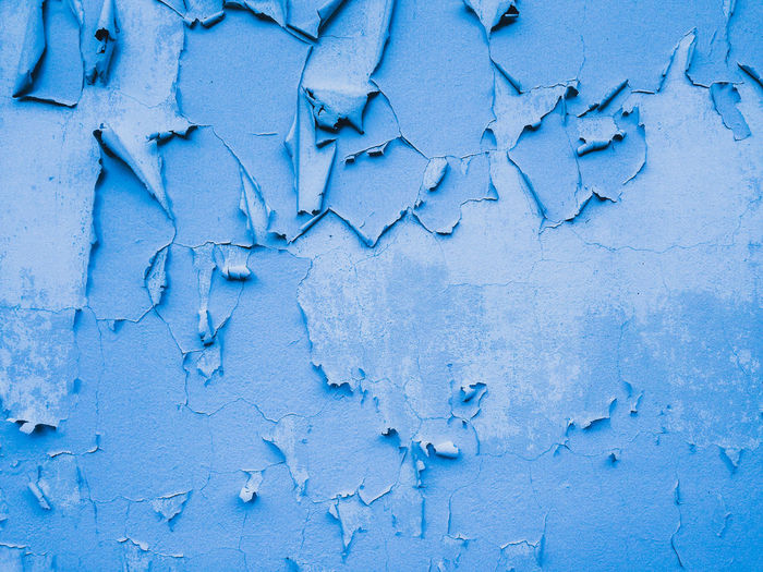 Full Frame Shot Of Blue Peeled Wall