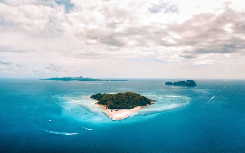 Bamboo Island from above, Thailand Thailandtravel Jungle Speedboat Phi Phi Paradise Beach Boatlife Dronephotography Boats Drone  Droneshot Phi Phi Islands, Thailand Sea Water Sky Cloud - Sky Beauty In Nature Scenics - Nature Land Travel Destinations Beach Nature Island Tranquility Travel Blue Horizon Over Water Horizon Aerial View