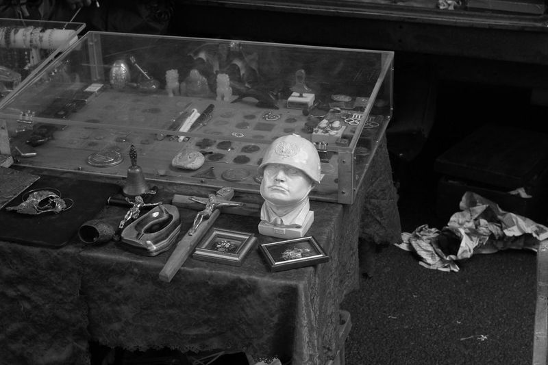 Black And White Bric à Brac Bust  Crucifix Day Il Duce Market Mussolini Outdoor Market Shopping Stalls Stalls At Sunday Market Sunday