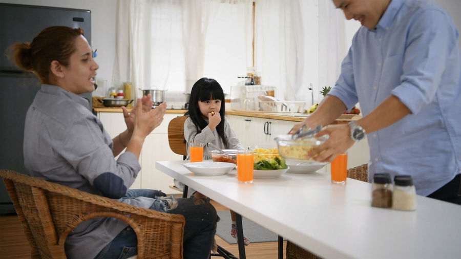 Food And Drink Group Of People Togetherness Women Men Lifestyles Adult Females Males  Real People Food Table Drink Domestic Room Holding Indoors  Standing Refreshment People Glass
