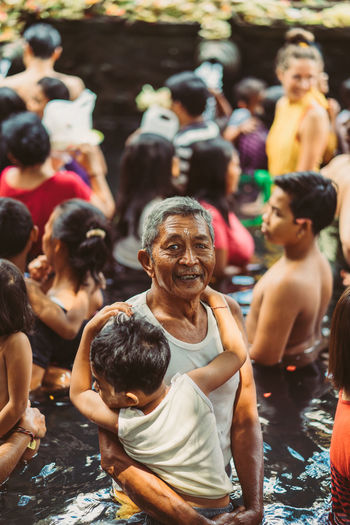 Bali INDONESIA Bali Temple Temple Water Temple Religious Festival Hindu Hinduism Real People Lifestyles Men Group Of People Women Crowd Leisure Activity Focus On Foreground People Day Adult Sitting Water Childhood Outdoors Nature Togetherness Males  Swimming Pool