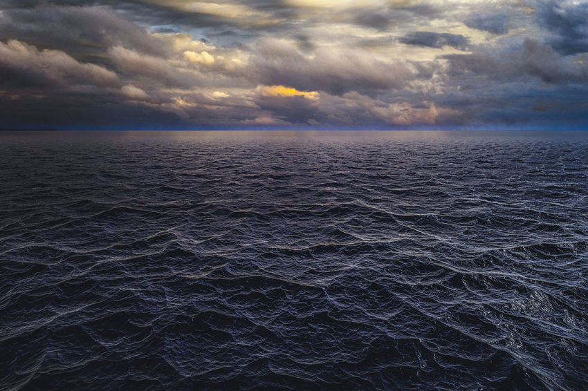 Dramatic sky over the ocean Beauty In Nature Cloud - Sky darkness and light Horizon Horizon Over Water Idyllic No People Rippled Scenics - Nature Sea Seascape Sky Sunset Water Waterfront Waves