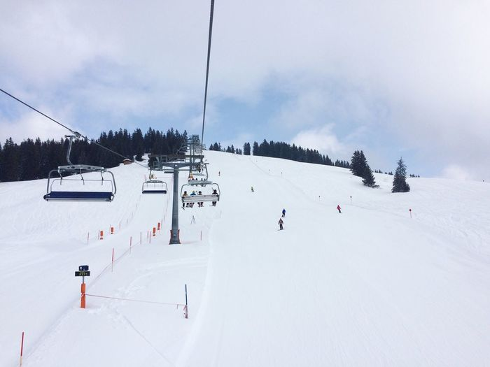 People skiing in mountains