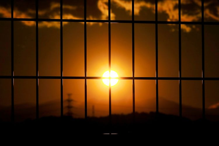 Sunset Sun Orange Color Sunlight Beauty In Nature Scenics No People Nature Travel Destinations Sky Outdoors EyeEm Nature Lover Sunset_collection Sunset View. Fence Sunset Through The Fence sunset of the city Be. Ready.