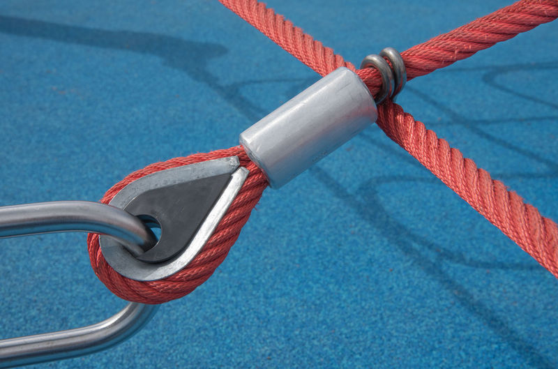 Rope Blue Strength Safety Tied Up Close-up Metal Tied Knot Connection No People Day Security Protection High Angle View Outdoors Transportation Focus On Foreground Durability Red Sunlight Silver Colored