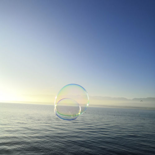Bubbles over sea against clear sky