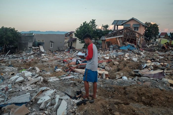 Palu After math Earthquake Real People Full Length One Person Architecture Lifestyles Built Structure Leisure Activity Sky Building Exterior Land Casual Clothing Women Beach Building Nature Females House