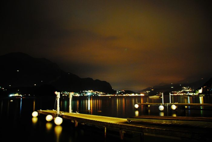 Beauty In Nature City Comer See Illuminated Mountain Night No People Outdoors Sea Sky Water