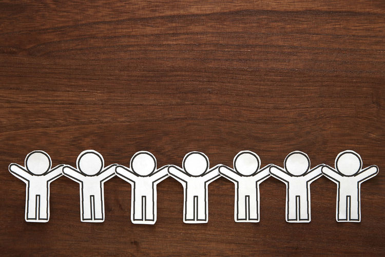 Bond Collaboration Community Company Holding Hands Relationship Shape Silhouette Teamwork Connection Cooperation Friendship Gather Hand Human Indoors  Network Paper Partnership People Shape Side By Side Team Together Wood - Material