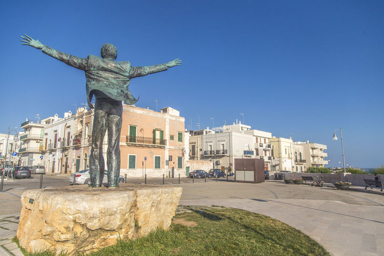 Statue of historic building against clear blue sky