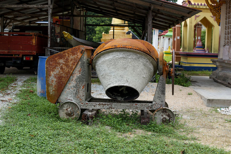 Concrete Mixer Machine Concrete Mixer Machine Architecture Metal No People Rusty Abandoned Day Old Built Structure Grass Mode Of Transportation Transportation Obsolete Field Nature Decline Deterioration Outdoors Land Run-down Damaged Ceiling Wheel