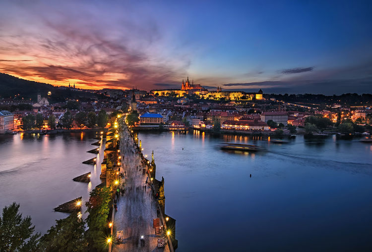 Charles bridge and St. Vitus cathedral sunset, Prague, Czech Republic Prague Czech Republic Charles Bridge St. Vitus Cathedral Architecture No People Built Structure Sky Building Exterior City Water Illuminated Night Cityscape Reflection River Dusk Transportation Nature Cloud - Sky Connection Bridge Bridge - Man Made Structure Outdoors