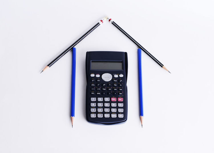 High angle view of calculator and pencil against white background