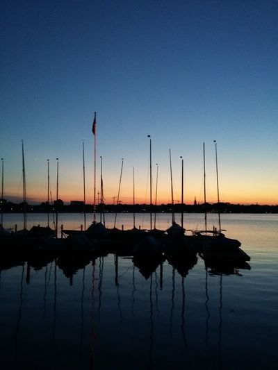 That's Hamburg. · Germany 040 Sunset Außenalster Alster Boats Sailboat Silhouette Reflections Light And Shadow Shades Of Blue Beauty In Nature Urban Landscape The Purist (no Edit, No Filter)