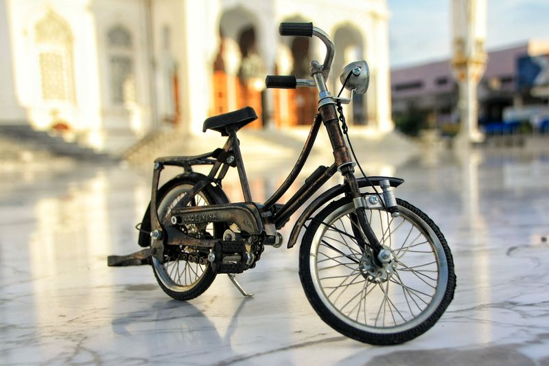 Aceh Transportation Mode Of Transportation Bicycle Land Vehicle Architecture No People Focus On Foreground City Built Structure Stationary Day Building Exterior Reflection Outdoors Street Building Travel Metal Close-up Water Wheel