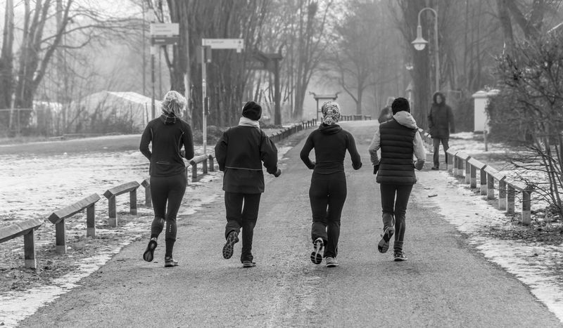 Adult Adults Only Bare Tree Black And White Cold Day Four Friendship Ice Jogger Jogging Men Outdoors People Quattro Real People Snow Sport Sport In The City Street Photography Tree Vier Winter Women