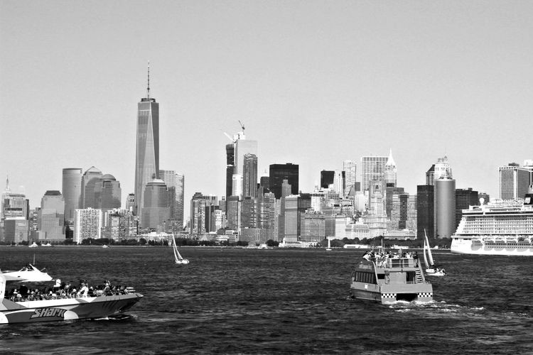New York Blackandwhite Monochrome City Cityscape Urban Skyline Nautical Vessel Skyscraper Water Modern Sea Downtown District Business Finance And Industry Financial District  Building Story High Rise Television Tower Tall - High Tourist Attraction  Office Building Exterior Skyline Tower Communications Tower Tall Ship Mast Infrastructure City Location
