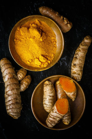 turmeric roots and powder Black Background From Above  Turmeric Powder Bowl Curcuma Curcuma Root Curcumin Root Directly Above Food Food And Drink Healthy Eating Indoors  No People Spice Superfood Turmeric  Turmeric Root