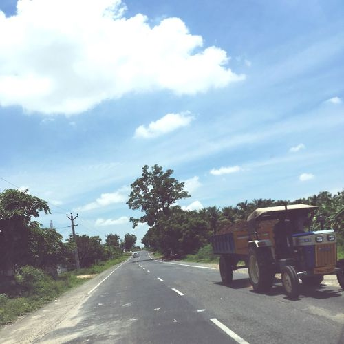 EyeEm Gallery Village Roads Sky Cloud - Sky Day No People Road Tree Transportation Outdoors Nature Tractor Sunlight Freshness The Way Forward Workers
