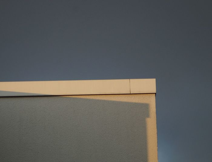 Close-up of white wall with shadowplay