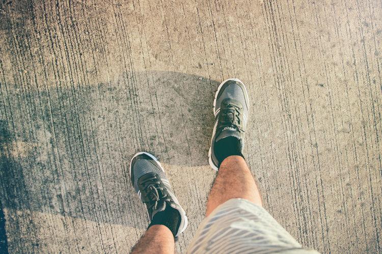 Running on street. Exercise Road Run Running Walk Activity Avtivities Beginnings Health Healthy Hobbies Hobby Human Body Part Human Foot Human Leg Lifestyles Men Outdoors Shoe Sport Standing Start Street Vintage Walking