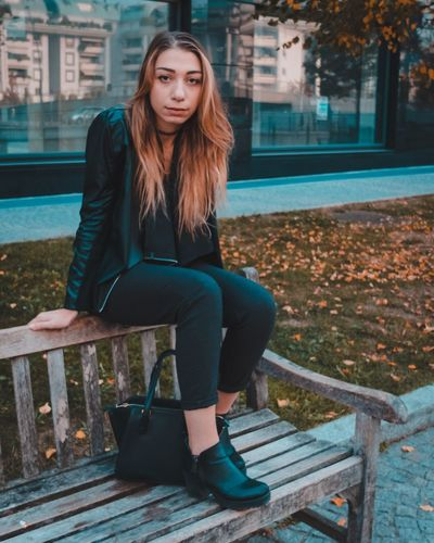 EyeEm Selects Sitting Full Length Outdoors Young Adult One Person Jacket Long Hair Day Young Women Casual Clothing Building Exterior Built Structure Beautiful Woman Real People Architecture Adult People EyEmselect EyEmNewHere Connected By Travel Summer In The City