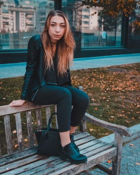 EyeEm Selects Sitting Full Length Outdoors Young Adult One Person Jacket Long Hair Day Young Women Casual Clothing Building Exterior Built Structure Beautiful Woman Real People Architecture Adult People EyEmselect EyEmNewHere Connected By Travel