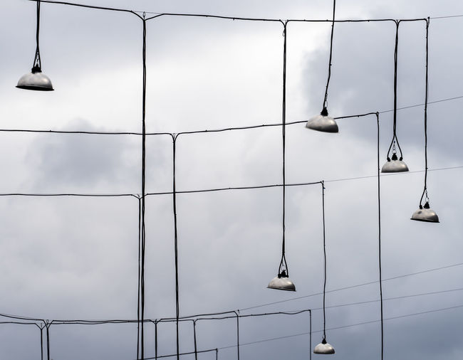 Lamps Hanging Mystery Mystic No People Lighting Equipment Sky Outdoors Architecture Nature Day Built Structure Cloud - Sky Building Exterior Metal Modern Repetition Animal Cable Low Angle View Full Frame Bird Building