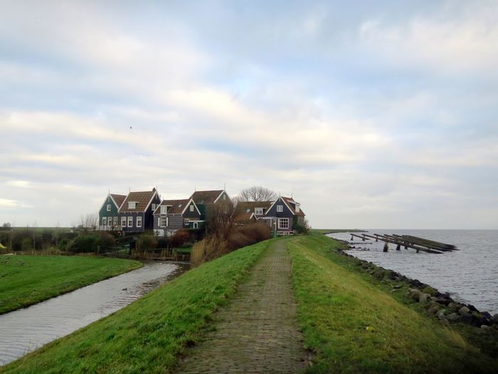 Marken Island - clustered together Water Sky Architecture Built Structure Nature Building Exterior Direction Outdoors Marken Marken Island Island Building Cloud - Sky Grass Plant The Way Forward Land House Footpath Scenics - Nature Residential District Houses Dutch Houses EyeEmNewHere