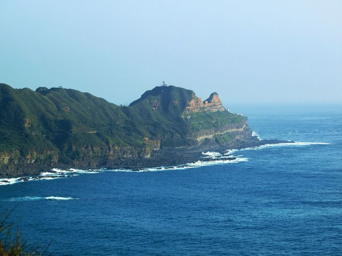 View of Cape Bitou, Taiwan, from the south-east. The location features a hiking trail from beyond the visible cape to the location form which the shot was taken (Longdongwan). Cape Bitou Gongliao District Hiking Longdongwan Taiwan Beach Beauty In Nature Clear Sky Day Horizon Over Water Mountain Nature No People Outdoors Rock - Object Scenics Sea Sky Tranquil Scene Tranquility Travel Destinations Water Wave