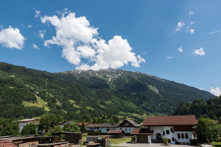 Houses on mountain against sky