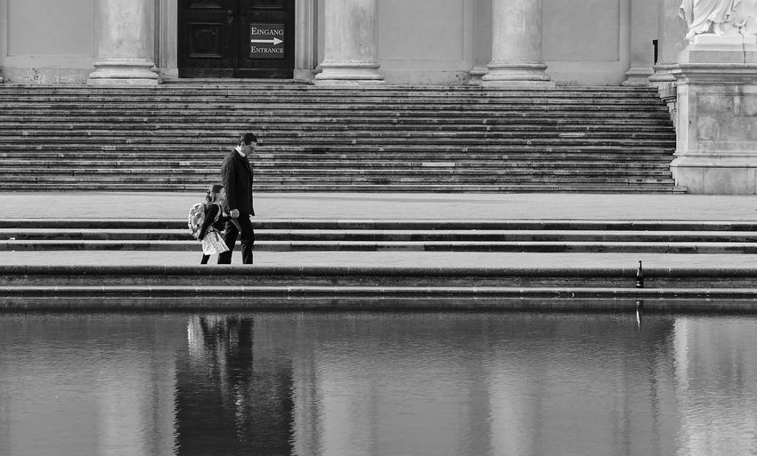 Father and daughter on their way to school Care City Life Dad Love Parental Guidance Quality Time Architecture Building Exterior Daddy's Girl Daughter Day Family Time Father And Daughter Feeling Safe Lifestyles Men Outdoors People Real People Reflexions Responsibility Safety School Way Walking Water
