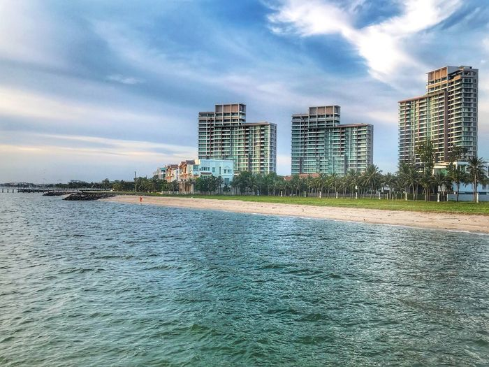 sea The Beach  The Beach Life Building Exterior Built Structure Architecture City Sky Cloud - Sky Building Water Nature Waterfront Office Building Exterior Sea No People Modern Day Cityscape Urban Skyline Residential District Skyscraper Outdoors