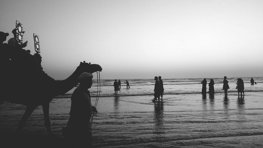 Silhouette people at beach