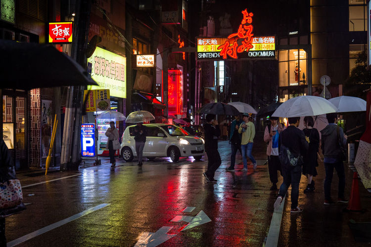 Okanomimura City Street Streetphotography Japan Photography Japan Hiroshima Cityscape Nightphotography Canonphotography Canon Rainy Season Real People People Mode Of Transportation Motor Vehicle Road Group Of People City Life Building Exterior Protection Illuminated Transportation Umbrella Built Structure Night Architecture Wet Rain Street City The Street Photographer - 2019 EyeEm Awards