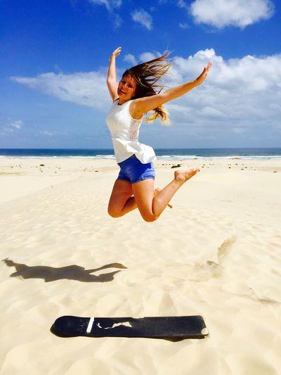 Sandboarding Outdoors Sand Board Fun Traveling Activities Blue Sky Girl Jumping Enjoying Life Sydney, Australia Port Stephens