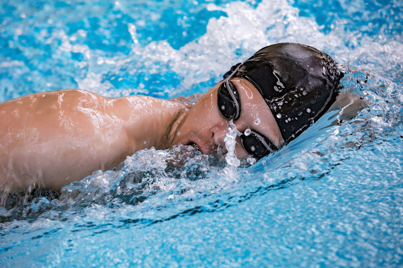 Competition Day Determination Exercising Eyewear Headshot Leisure Activity Lifestyles Men Motion Nature One Person Outdoors Pool Portrait Sport Swimming Swimming Cap Swimming Pool Swimwear Water