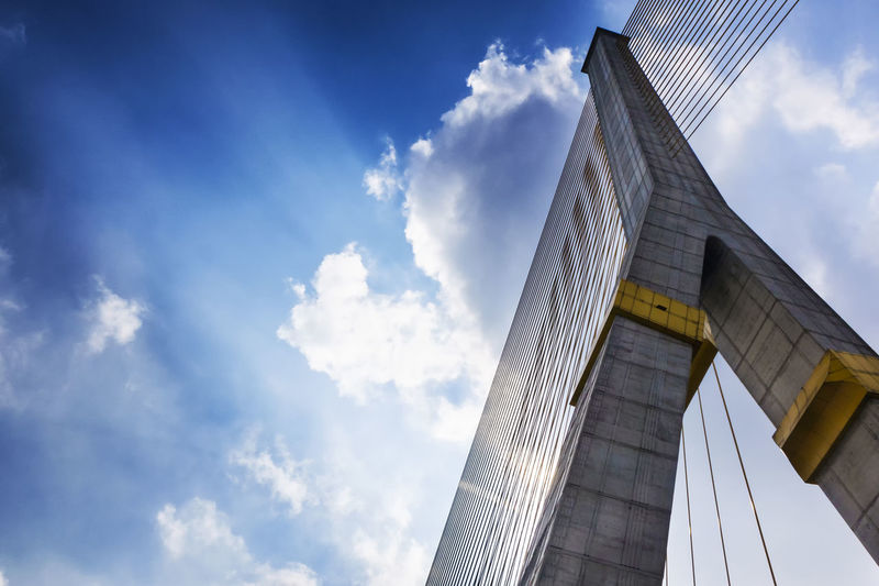 Low angle view of rama viii bridge against sky in city