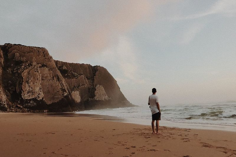 Beach Sea Rock - Object Sand Full Length Rear View One Person One Man Only Sky Nature Vacations Men Horizon Over Water People Beauty In Nature Scenics Adults Only Adult Outdoors Only Men