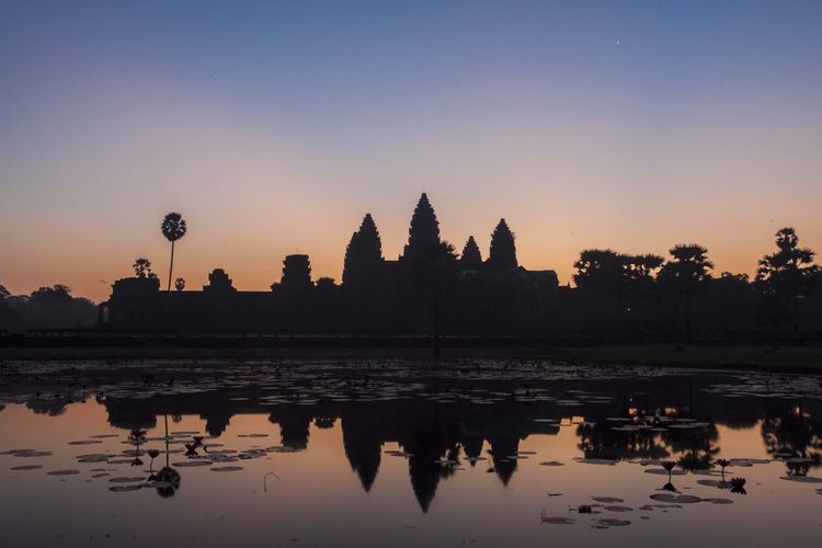 Silhouette Of Angkor Wat Against Sky During Sunset
