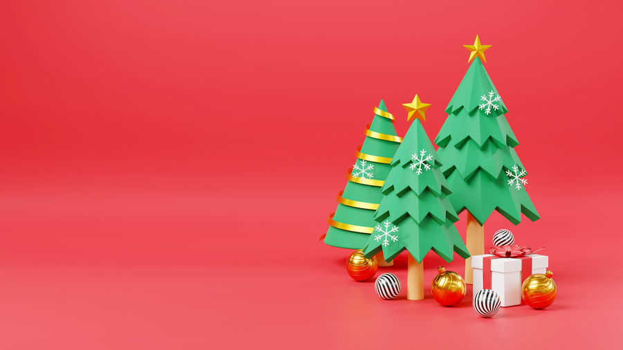 Christmas decorations against red background